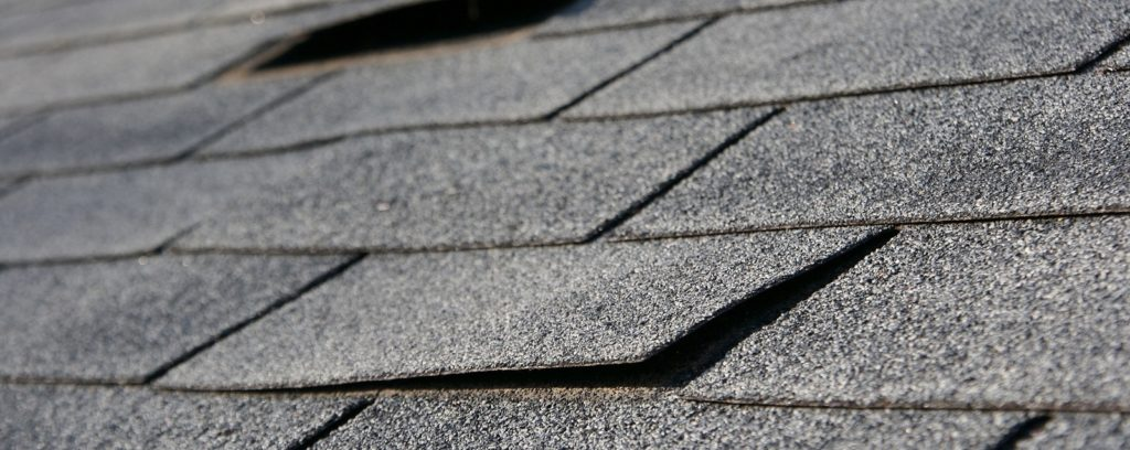 damaged residential roof shingles